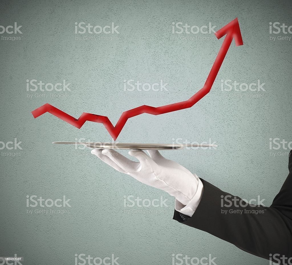 Businessman holds a tray with statistics stock photo