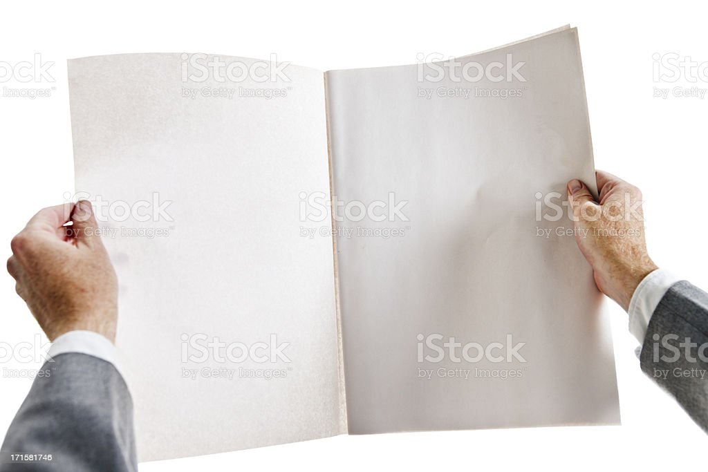Businessman holds blank newspaper open to centre spread. stock photo