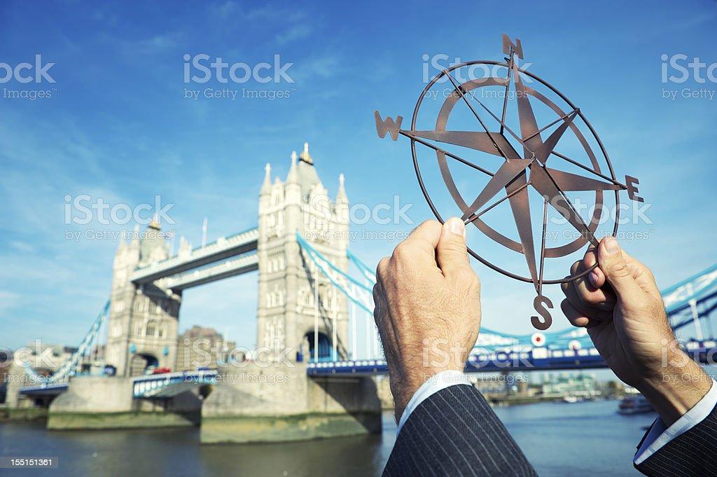 Businessman Holds Compass Above London Skyline royalty-free stock photo