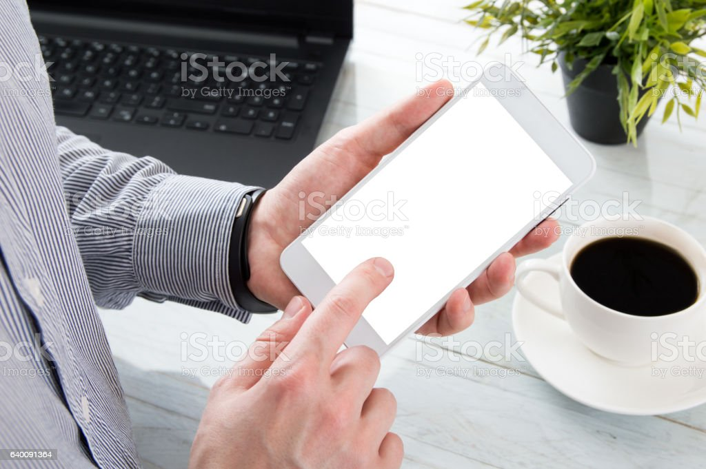 Businessman holds finger on his white smartphone stock photo