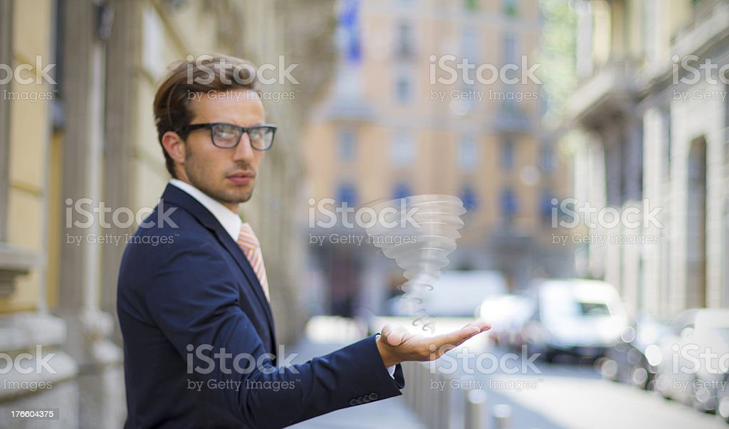 Businessman Holds his Hand Out with twister idea royalty-free stock photo