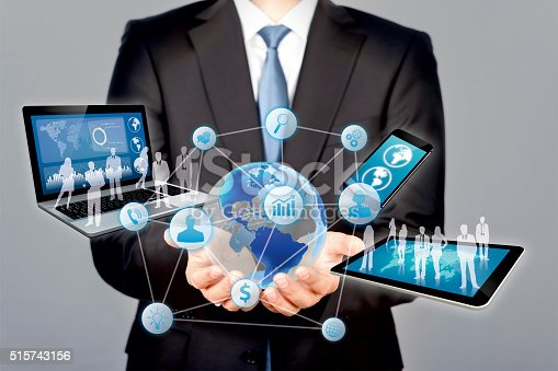 Technology Management Image: Businessman Holds Modern Technology In Hands Stock Photo