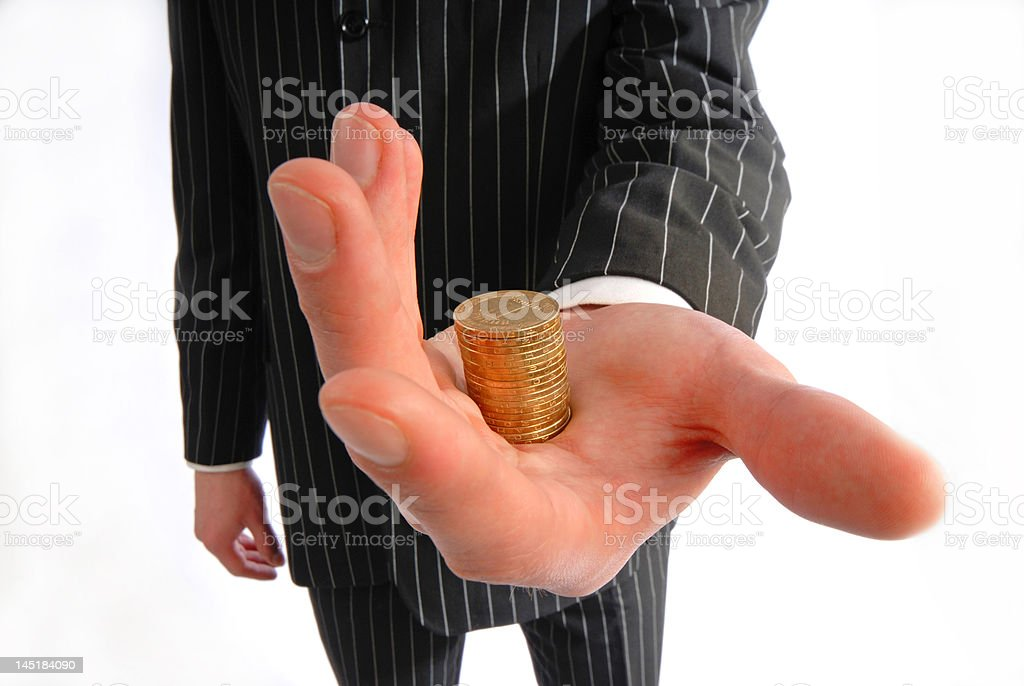 businessman holds  pile of coins royalty-free stock photo