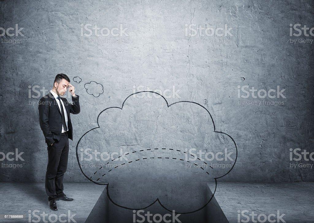 Businessman imaging bridge over gap stock photo