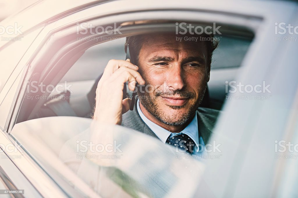 Businessman in a car stock photo