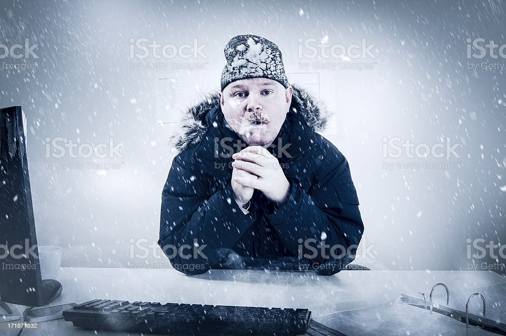 Businessman in a Cold Office with Snow and Ice Office worker with mustache in cold snow. Frosty Cold Temperature Stock Photo