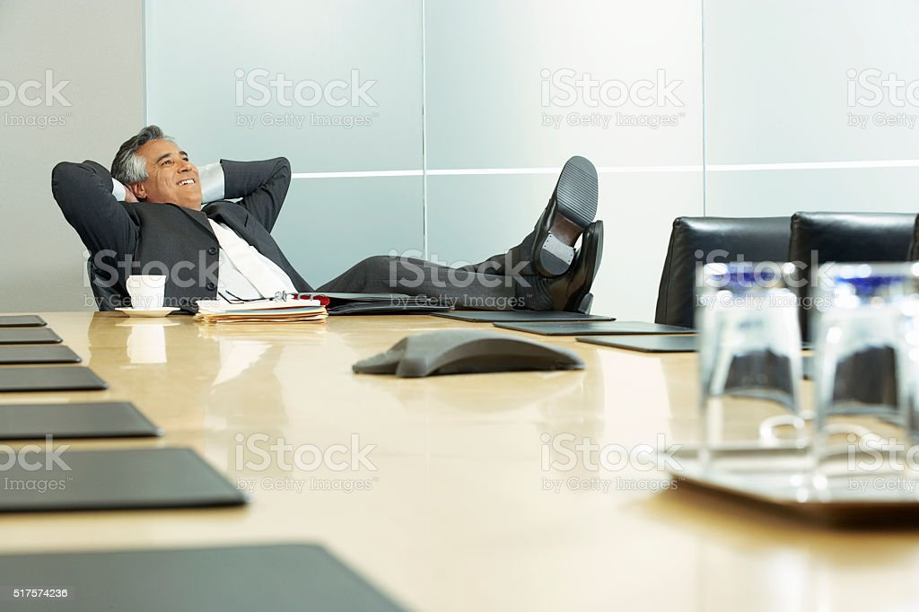 Businessman in a conference room stock photo