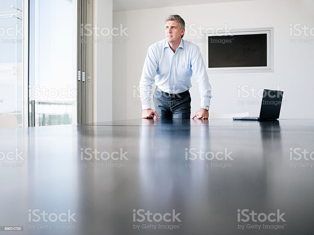 Businessman in a conference room royalty-free stock photo