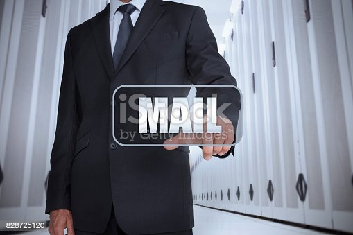 Businessman in a data center selecting label with mail written on it