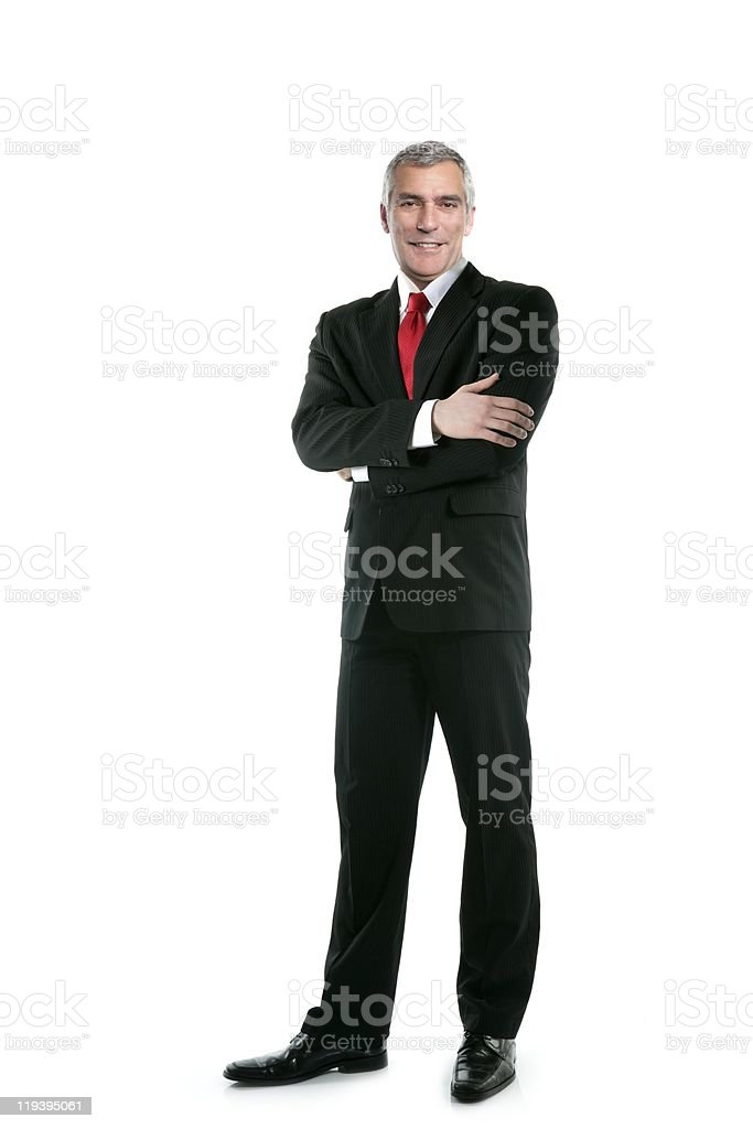 Businessman in a full length suit and red tie and posing stock photo