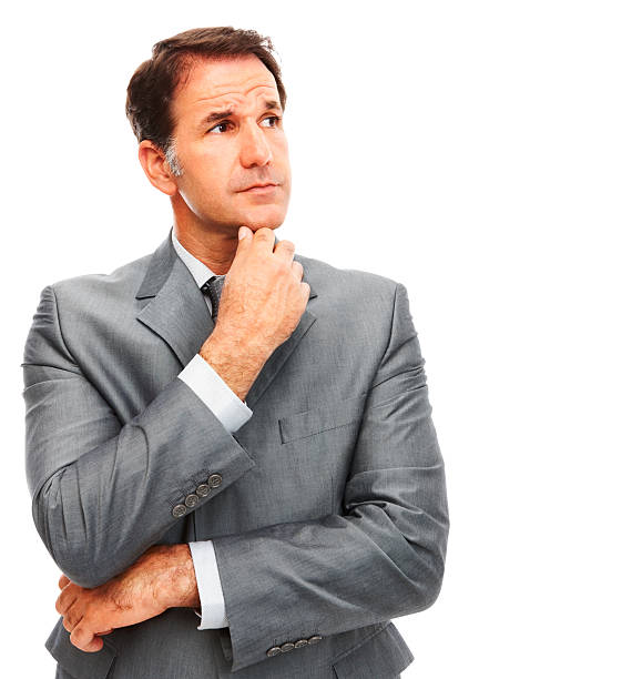 Businessman in a gray suit standing up and staring stock photo