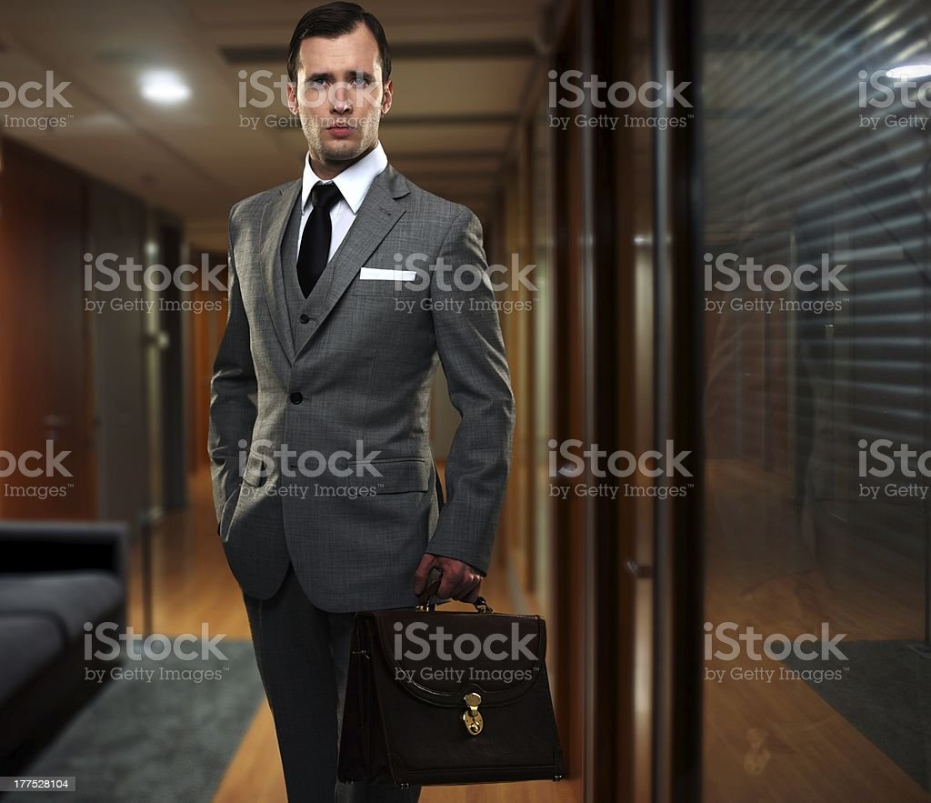 Businessman in a hallway stock photo