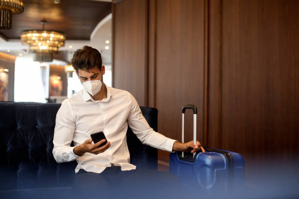 Businessman in a hotel lobby during pandemic stock photo