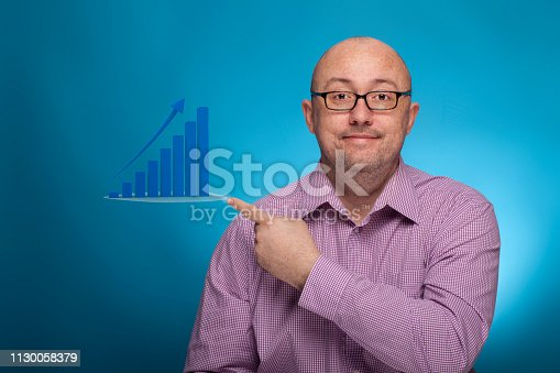 istock A businessman in a piked shirt pointing with the index finger and infographic,  on the blue background. 1130058379