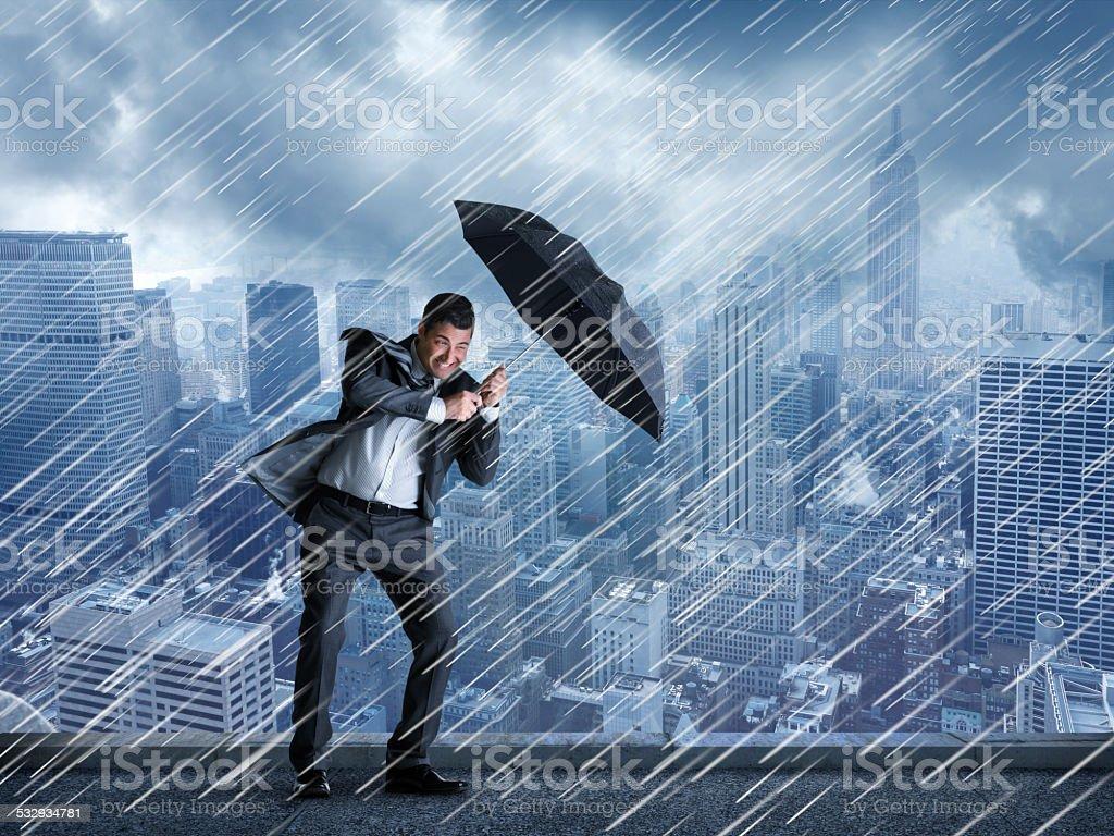 Businessman In A Rainstorm stock photo