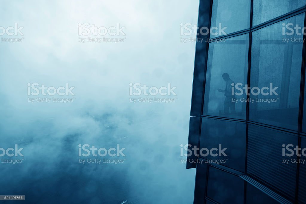 businessman in a skyscraper stock photo