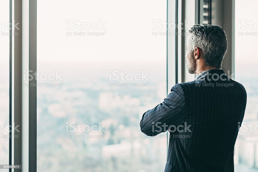 Businessman in a skyscraper royalty-free stock photo