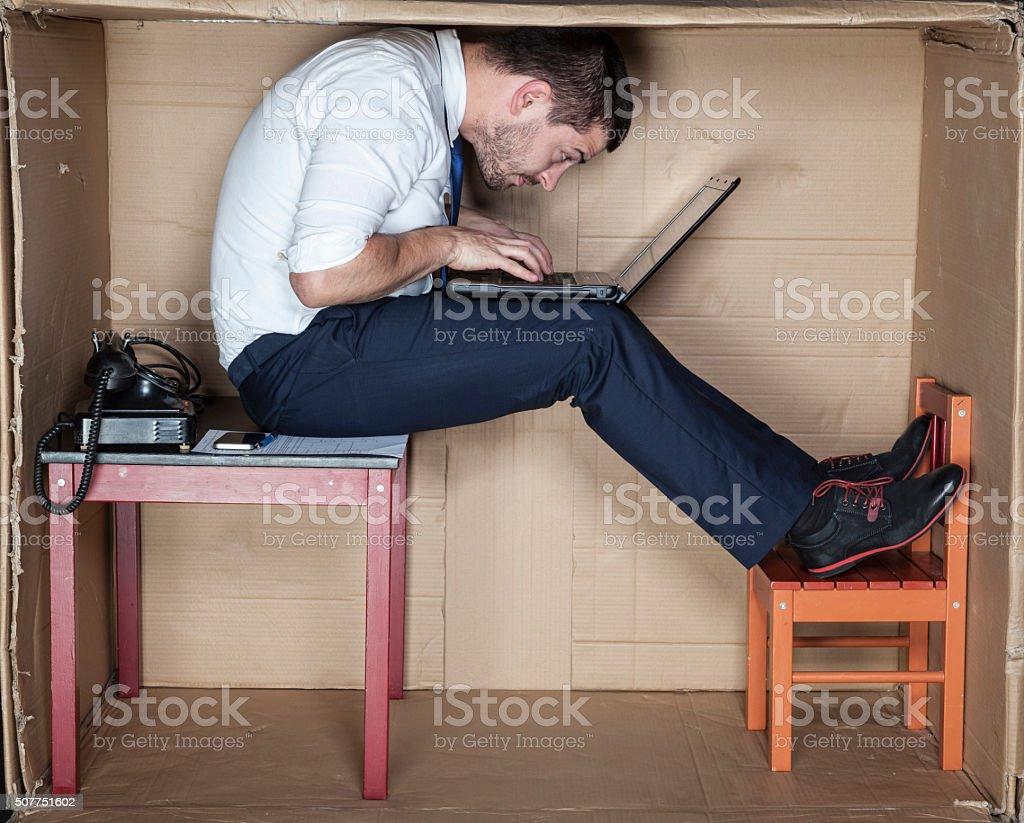 Geschäftsmann in einer etwas merkwürdigen Lage Lizenzfreies stock-foto