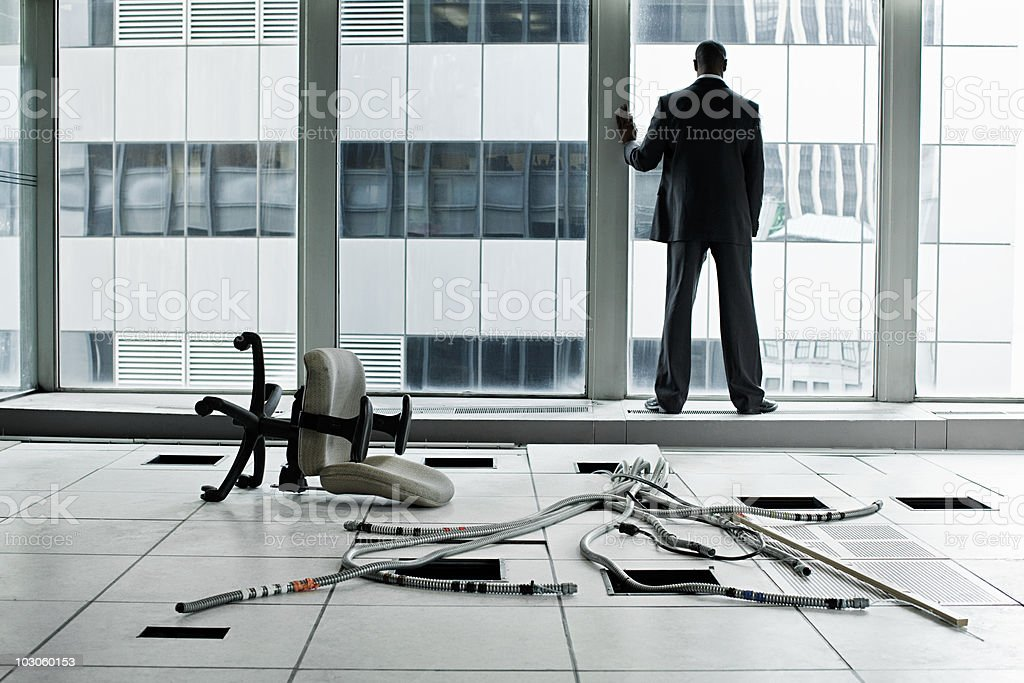 Businessman in abandoned office stock photo