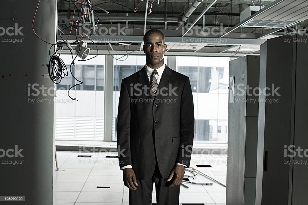Businessman in abandoned office royalty-free stock photo
