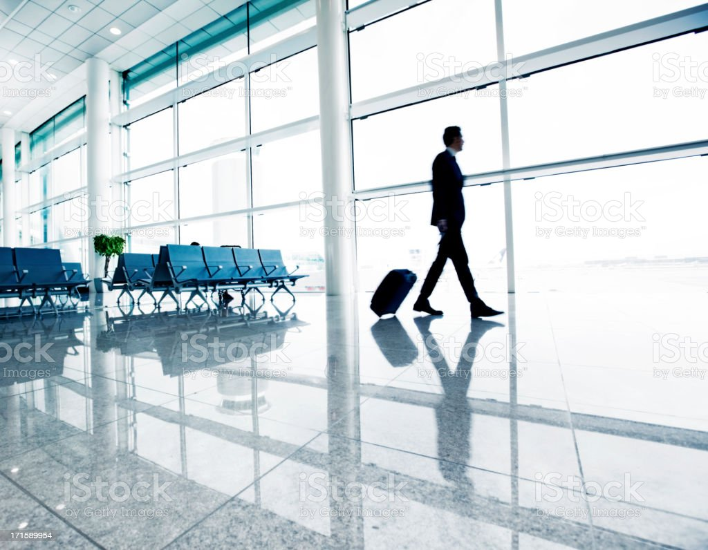 Businessman in airport stock photo
