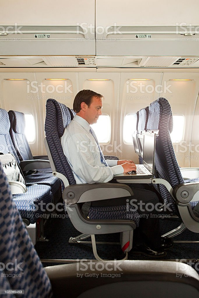 Businessman in an airplane stock photo