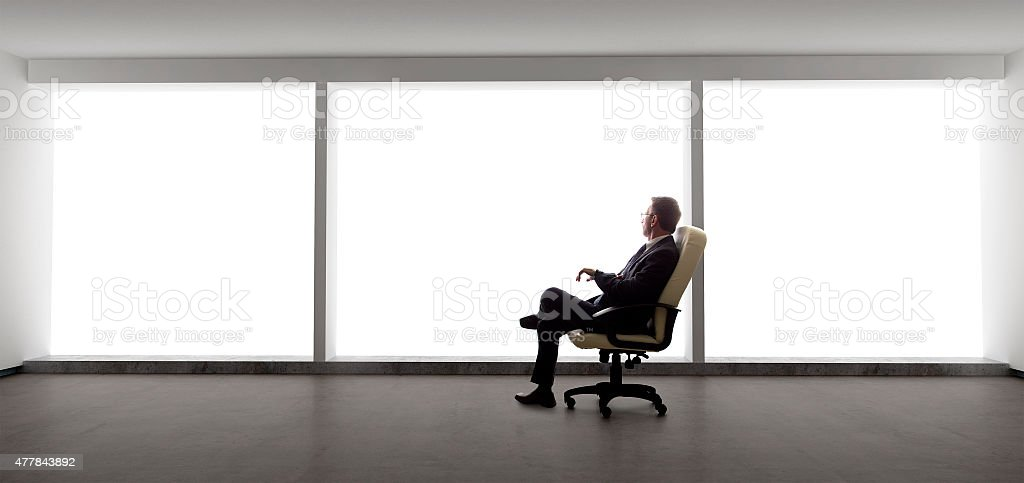 Businessman in an Empty Office stock photo