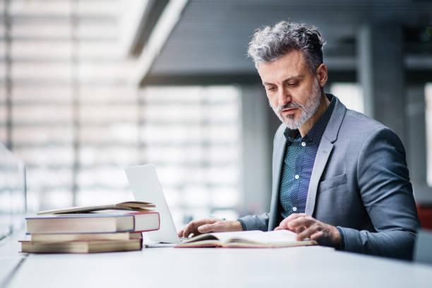 Businessman in an office studying picture id925283678?b=1&k=6&m=925283678&s=612x612&w=0&h=qklrjtzr o1p8htyyqahknitfo6bodipswqk9txdvt8=
