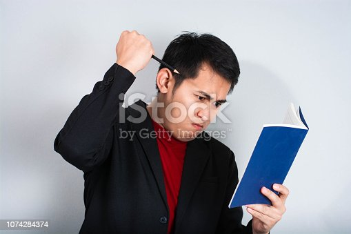 businessman in anger with fists clenched screaming,Angry businessman shout with book