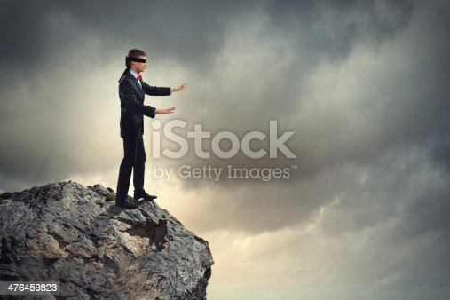 istock Businessman in blindfold 476459823