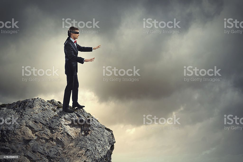 Businessman in blindfold stock photo