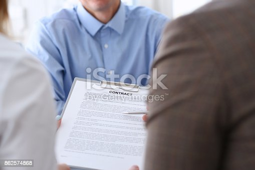 863148614istockphoto Businessman in blue shirt offer contract form on clipboard pad 862574868