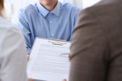 863148614 istock photo Businessman in blue shirt offer contract form on clipboard pad 862574868