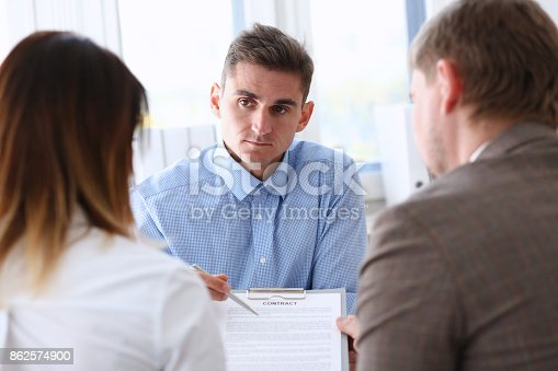 863148614istockphoto Businessman in blue shirt offer contract form on clipboard pad 862574900