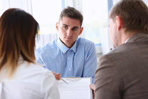 863148614 istock photo Businessman in blue shirt offer contract form on clipboard pad 862574900