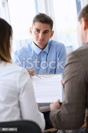 863148614istockphoto Businessman in blue shirt offer contract form on clipboard pad 863148614