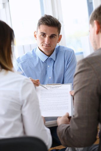 863148614 istock photo Businessman in blue shirt offer contract form on clipboard pad 863148614