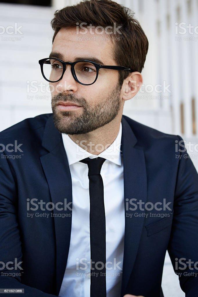 Businessman in blue suit, looking away photo libre de droits
