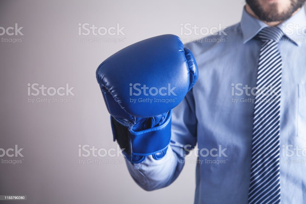 Businessman in boxing gloves. Business, Power, Sport