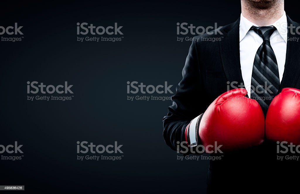 businessman in boxing gloves royalty-free stock photo