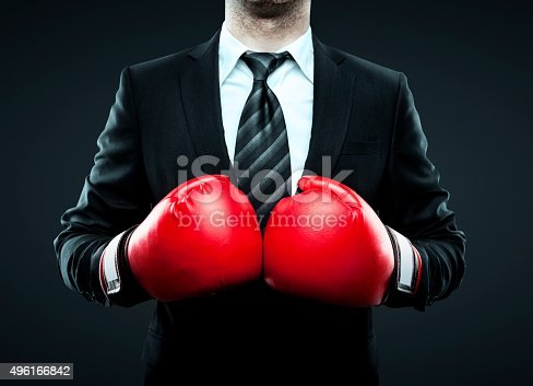 istock businessman in boxing gloves 496166842