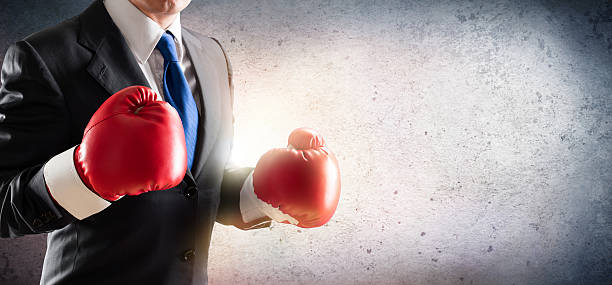 Businessman In Boxing Gloves stock photo