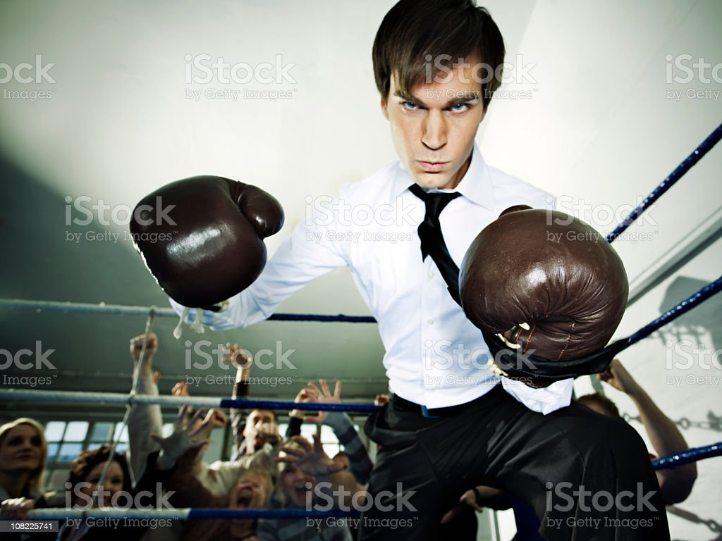 Businessman in Boxing Ring stock photo