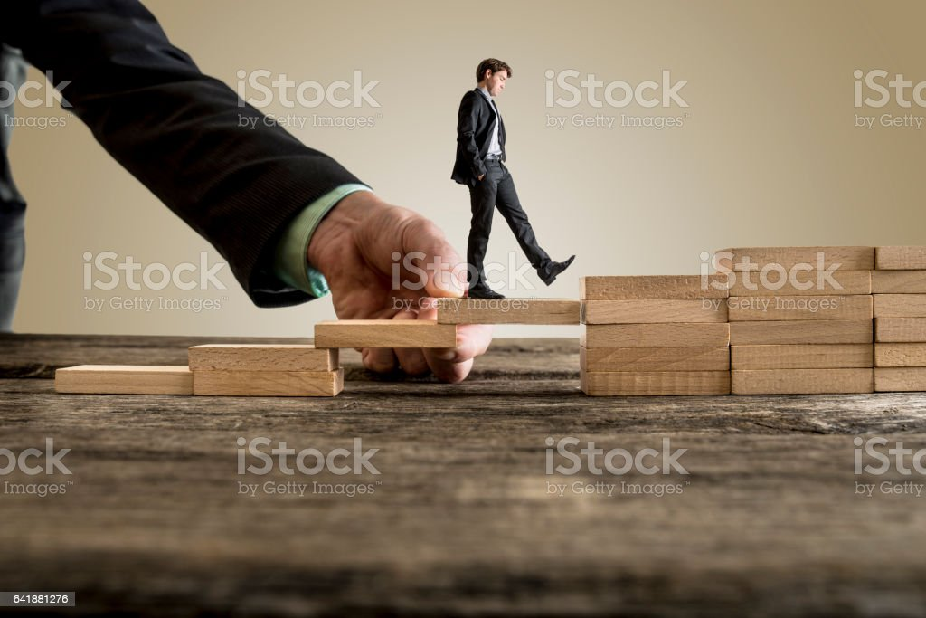 Businessman in business suit walking up steps - Foto stock royalty-free di Accudire