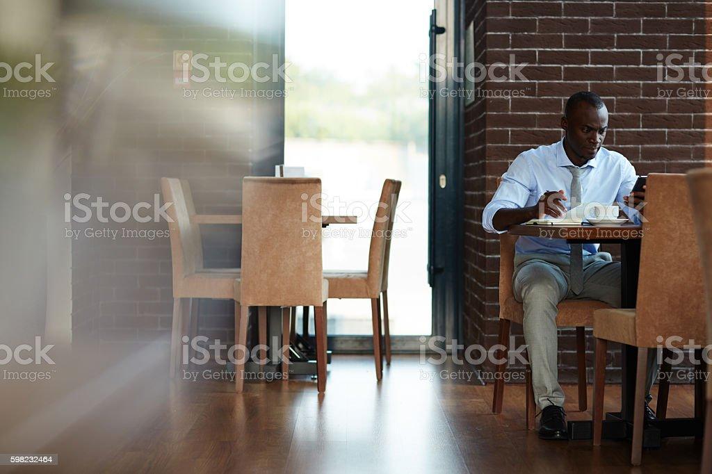 Empresário no cafe  foto royalty-free