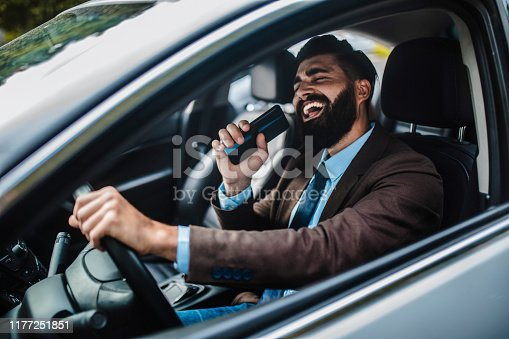 Businessman in car Businessman driving car