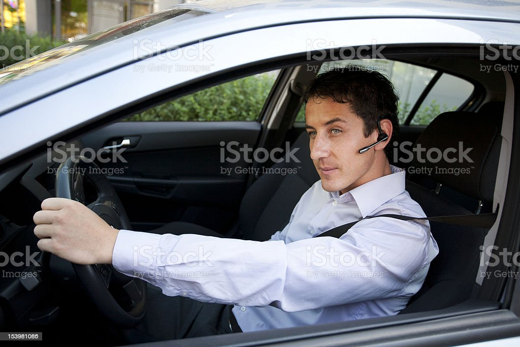 Businessman in car with bluetooth royalty-free stock photo