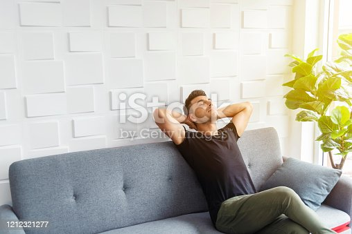 Businessman in casual relaxing on sofa with soft sunlight. Happy life. Breaking time.