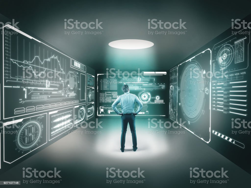Businessman in center of a room looking to a digital maze, izolated in a room with hi tech graphs royalty-free stock photo