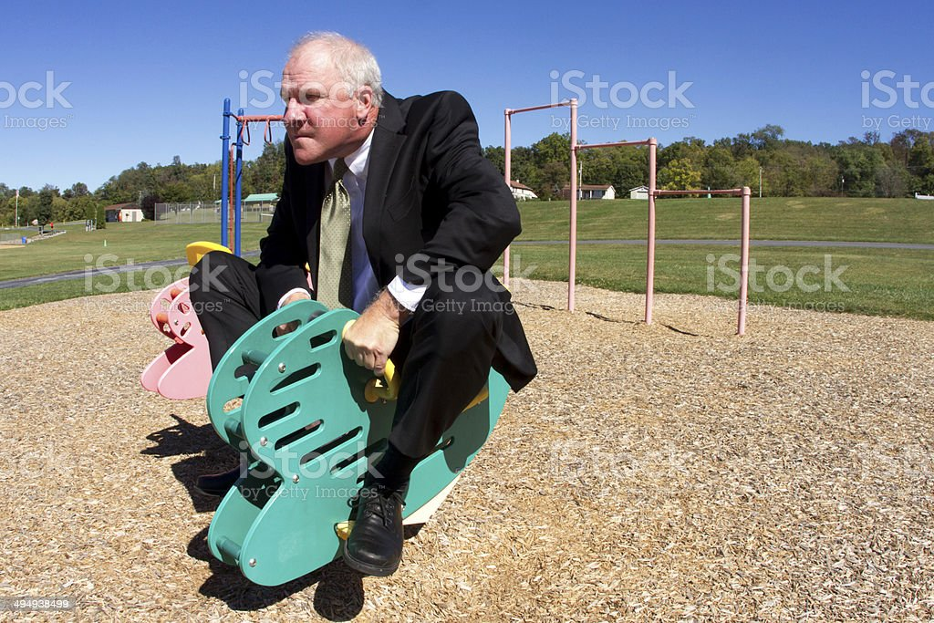 Businessman in Childish Competition stock photo